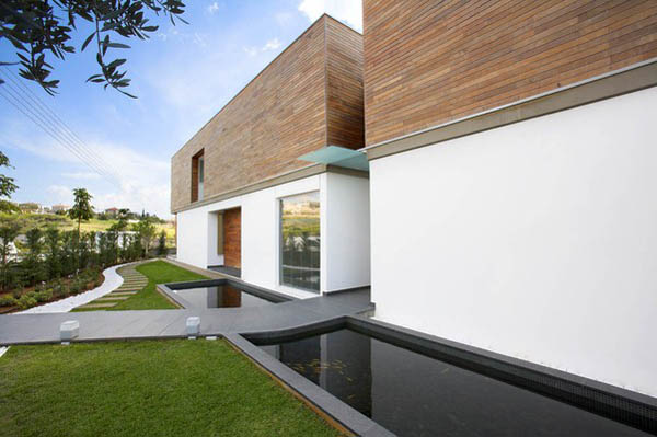 Adamos Residence 3 Airy Residence in Cyprus Combining Wood and Glass on a White Background