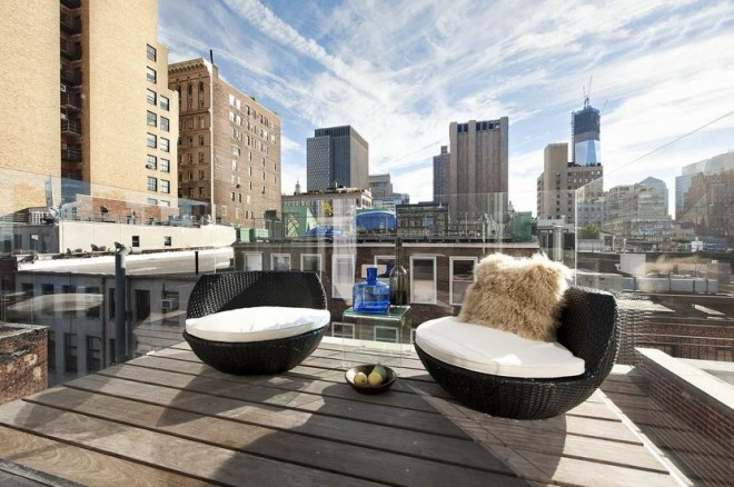 new york loft deck off master bedroom city view glass railing cococozy 660x438 Chic Loft in New York