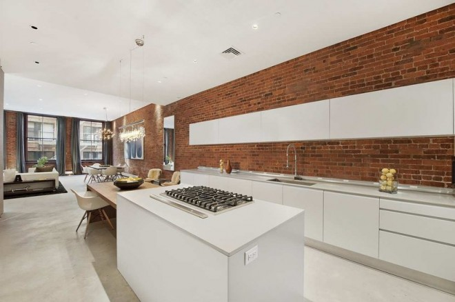 new york loft white modern sleek open kitchen cococozy exposed brick concealed appliances 660x438 Chic Loft in New York
